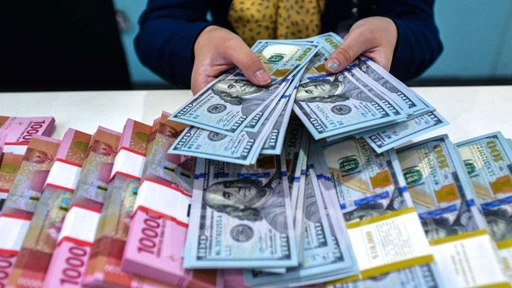 Ilustrasi rupiah dan dolar AS